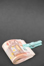 Euro money wad of bills held together with a clothespin very selective focus on the corner at the bottom copy space above Royalty Free Stock Images