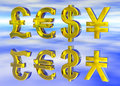 Euro Pound Dollar and Yen Symbols in Gold Stock Image