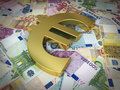 Euro sign and banknotes d render golden symbol on close up Stock Photo