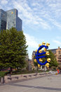 Euro sign the famous big at the european central bank frankfurt germany with man cleans the road with a pressure washer Stock Image