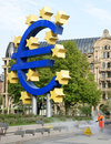 Euro sign the famous big at the european central bank frankfurt germany with man cleans the road with a pressure washer Royalty Free Stock Image