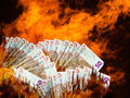 Euro stock market or currency collapse decline money notes really hot burning concept Royalty Free Stock Photo
