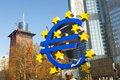 Euro symbol in front of the european central bank with occupy ca frankfurt january protest camp frankfurt movement at it is part Stock Photo