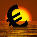 Euro Symbol Sinking And Sunset Showing Depression Royalty Free Stock Photo
