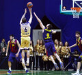 Euroleague basketball game budivelnik kyiv vs fc barcelona ukraine november blake ahearn of in yellow fights for a ball with Stock Images