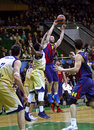 Euroleague basketball game budivelnik kyiv vs fc barcelona ukraine november in yellow and players fight for a ball during their Royalty Free Stock Image