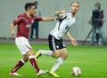 Europa league rapid bucharest legia warsaw s danijel ljuboja r and s rui duarte s pictured in action during an group stage game Royalty Free Stock Images