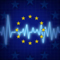 Europe crisis concept and european union challenges symbol with an ecg or ekg monitor lifeline over a flag icon as a metaphor for Royalty Free Stock Images