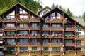 European alpine ski resort chalet hotel, front view Royalty Free Stock Photo