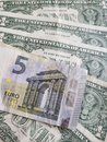 European banknote of five euro and american one  dollar bills Royalty Free Stock Photo