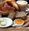 European breakfast – coffee, croissants, toasts, butter, jam Royalty Free Stock Photo