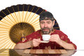 European in chinese suit drinking tea Royalty Free Stock Images