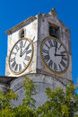 European church with tower and huge clock in portugal close to tavira Stock Images