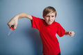 European-looking boy of ten years holding a knife Royalty Free Stock Photo