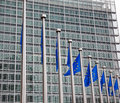 European parliament brussels belgium flags in front of the berlaymont building headquarters of the commission in Stock Photo
