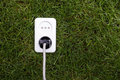 European power socket on grass. Energy concept Stock Photos