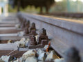 European rail construction with a rusty screw and nut horizon Royalty Free Stock Photo