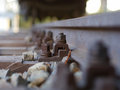 European rail construction with a rusty and nut Royalty Free Stock Photo