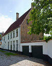European small street with old brick houses bruges belgium Royalty Free Stock Photo