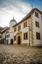 European street scene traditional buildings on an empty cobbled in a town in europe Royalty Free Stock Images