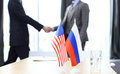 European Union and American leaders shaking hands on a deal agreement. Royalty Free Stock Photo