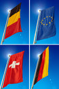 European union belgium germany switzerland flags vertical waving in the blue sky Stock Images