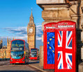European Union and British Union flag on phone booths against Big Ben in London, England, UK, Stay or leave, Brexit Royalty Free Stock Photo