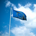 European union flag floats in the air with clouds and blue sky behind Stock Photos
