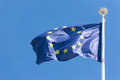 European union flag fluttering in a brisk breeze against a blue sky Royalty Free Stock Images