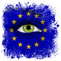 European union flag painted on face with green eye Royalty Free Stock Photos