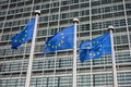 European union flags in front of the berlaymont building commission in brussels belgium Stock Image