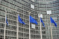 European union flags in front of the berlaymont building commission in brussels belgium Stock Photos