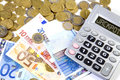 Euros Coins, Bank notes and calculator machine on a white backgr Royalty Free Stock Image