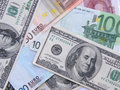 Euros and dollars Stock Images