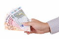 Euros money in man hand isolated on white Royalty Free Stock Images