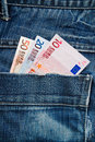 Euros in pocket euro banknotes of blue jeans trousers Stock Image