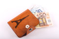 Euros in wallet leather paris and banknotes over white background Royalty Free Stock Photo