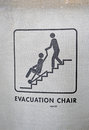 Evacuation chair sign on textured surface, help Stock Photography