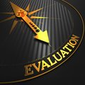 Evaluation concept on black with golden compass needle a field pointing Royalty Free Stock Photography