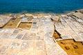 Evaporation ponds at the coast malta man made for salt production Stock Photos