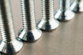 An even number of heads of metal bolts Royalty Free Stock Photos