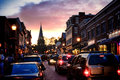 Evening in annapolis cars traffic jam and festive crowd gathering under streetlights on busy main street at dusk the maryland Royalty Free Stock Image
