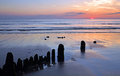 Evening on the coast light sunset at westward ho devon england Royalty Free Stock Images
