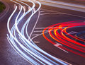 Evening crossroad with varicolored lines of lights of cars abstraction Stock Photo