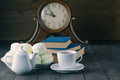 Evening with hot tea, sweets and books on wood table Royalty Free Stock Photo