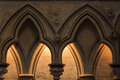 Evening light behind arches at the norman built stone cathedral at lincoln england Royalty Free Stock Image