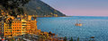 Evening panorama of camogli with purple sky and sailing ship Royalty Free Stock Photo