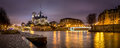 Evening panoramic of Notre Dame de Paris Cathedral on Ile de La Cite with the Seine River. France Royalty Free Stock Photo