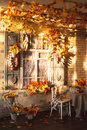 Evening patio. Window with vintage shutters decorated with autum Royalty Free Stock Photo
