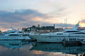 The evening port yachts in of cannes with old city on background france Stock Photos